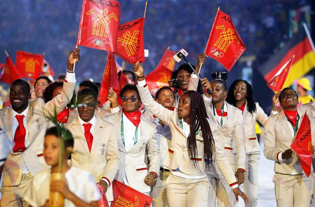 Athletes of Angola walk into the Maracana Stadium during the Opening Ceremony of the Rio 2016 Olympic Games in Rio de Janeiro, Brazil, 05 August 2016. (Photo by Sergey Ilnitsky/EPA)