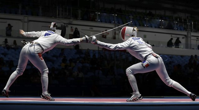 Auriane Malle of France, right, and Nguyen Thi Nhu Hoa of Vietnam compete in the women's individual epee event the 2016 Summer Olympics in Rio de Janeiro, Brazil, Saturday, August 6, 2016. (Photo by Andrew Medichini/AP Photo)