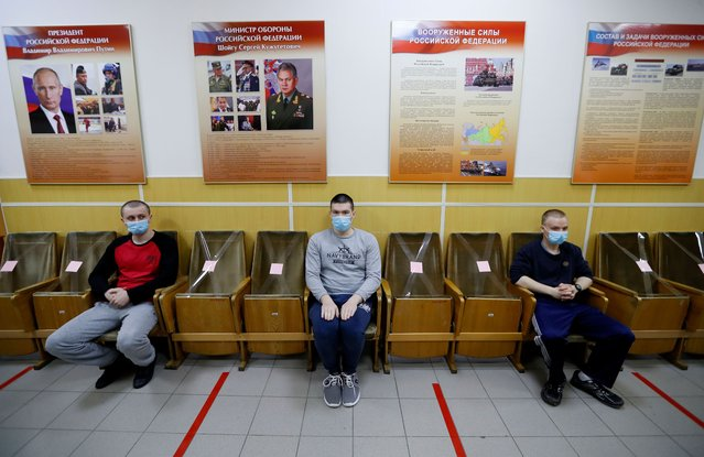 Russian recruits wait for a medical check-up in the recruitment center in St. Petersburg, Russia, 20 May 2020. According to a decree of the Russian President, 135,000 people will be sent to the army during the spring call-up. Amid the pandemic Covid-19 disease caused by the SARS-CoV-2 coronavirus, since 20 May 2020 Russian military recruiting offices have begun sending recruits of the spring army call-up to the army, keeping in line with strict sanitary measures. All conscripts are necessarily tested for coronavirus COVID-19 infection, their relatives are not allowed to the sites of the ceremony of taking the military oath by conscripts. All conscripts after arrival to the site of military units deployment will undergo a two-week quarantine. (Photo by Anatoly Maltsev/EPA/EFE/Rex Features/Shutterstock)