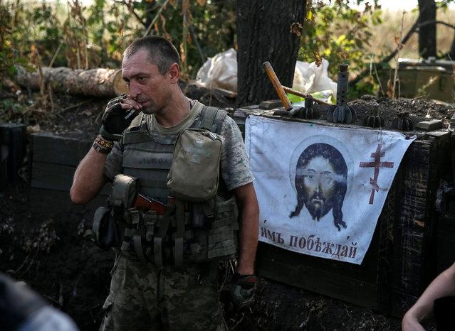 Ukrainian serviceman is seen at his position on the front line in Krasnogorivka near Donetsk, Ukraine, August 12, 2016. (Photo by Gleb Garanich/Reuters)