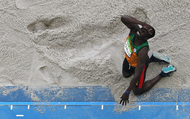 Guyana's Troy Doris reacts to a jump in the triple jump finals during the athletics competitions of the 2016 Summer Olympics at the Olympic stadium in Rio de Janeiro, Brazil, Tuesday, August 16, 2016. (Photo by Morry Gash/AP Photo)