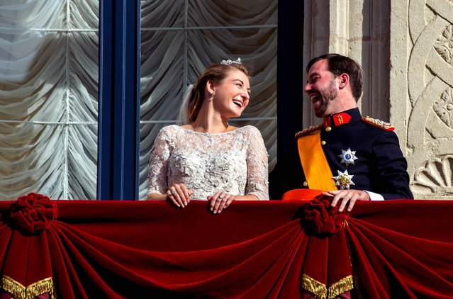 Luxembourg's Prince Guillaume and Countess Stephanie appear on the balcony of the Royal Palace after their wedding in Luxembourg October 20, 2012. (Photo by Geert vanden Wijngaert/Associated Press)