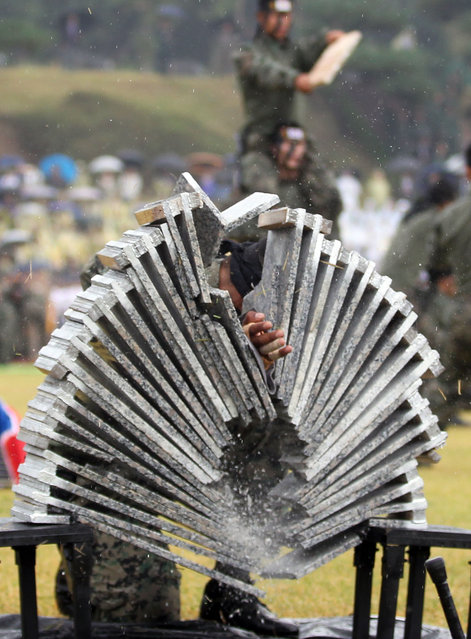 Soldiers demonstrate breaking boards at an event in the Gyeryongdae military headquarters in Gyeryong City, South Chungcheong Province, on September 29, 2014, ahead of the 66th anniversary of the foundation of the country's military, which falls on October 1. (Photo by EPA/YNA)