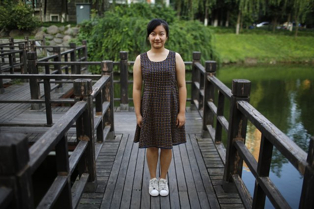 "Zhao Mengge, who was born in 1997, poses for a photograph in Shanghai September 6, 2014. ""Yes I'd like to have sisters. Little sisters are not naughty and they are easier to look after"", said Mengge. (Photo by Carlos Barria/Reuters)"