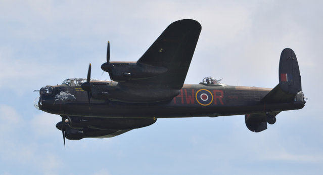 Avro Lancaster of the Battle of Britain Memorial Flight – Flying Legends Airshow Duxford 2012. The Avro Lancaster is the most famous and successful RAF heavy bomber of World War Two. It is a legend that lives on today and the contribution made by the aircraft and its crews to the freedom of our nation will, hopefully, never be forgotten. The prototype Lancaster took to the air for its first flight from Woodford, Manchester, on 9th January 1941; the first production Lancaster flew later that year on 31st October. The first RAF unit to receive the new aircraft for operations (on Christmas Eve 1941) was No 44 Squadron at Waddington, quickly followed by 97 Squadron at Woodhall Spa. The performance of the Lancaster was simply outstanding. It could carry a maximum bomb load of 22,000 lb, its maximum level speed with a full load at 15,000 feet was 275 mph and it could cruise routinely at altitudes above 20,000ft at a range speed of 200 mph. With a full bomb load the aircraft had a range in excess of 1,500 miles. The Lancaster's performance, its ruggedness, reliability and to many its sheer charisma, endeared it to its crews who were proud to fly this famous thoroughbred. (Rob Lovesey)