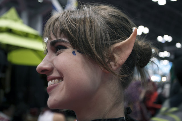 An attendee with prosthetic elf ears poses inside New York's Comic-Con convention. (Photo by Siemond Chan)
