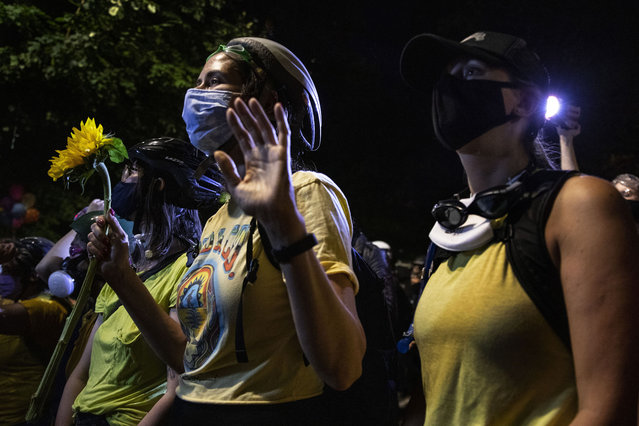 A female protester group called the Moms is seen during their nightly protest on July 20, 2020 in Portland, Oregon. The federal police response to the ongoing protests against racial inequality has been criticized by city and state elected officials as President Trump threatens to use Federal law enforcement in other major cities as well.  (Photo by Paula Bronstein/Getty Images)