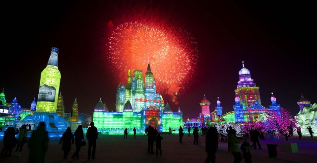 Visitors watch fireworks during the opening ceremony of the Harbin International Ice and Snow festival on January 5, 2012. (Photo by Andy Wong/Associated Press)