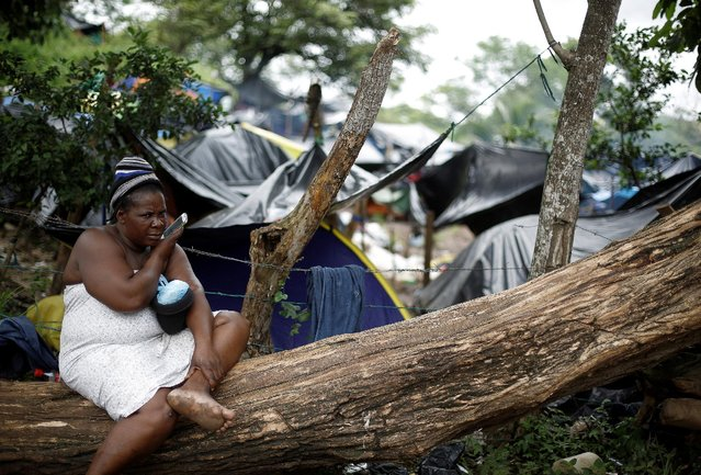 An African migrant stranded in Costa Rica speaks on her mobile phone at camp at the border between Costa Rica and Nicaragua, in Penas Blancas, Costa Rica, September 7, 2016. (Photo by Juan Carlos Ulate/Reuters)