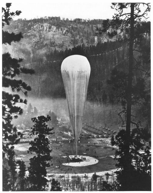 """South Dakota, United States, 1935. The National Geographic-Army Air Corps stratosphere balloon Explorer II prepares to rise from the Stratobowl near Rapid City, S.D., on November 11, 1935. It carried two œ""""aeronauts"""" 72,395 feet (nearly 14 miles) into the stratosphere – the highest men would go for the next 21 years. (Photo by H. Lee Wells"""