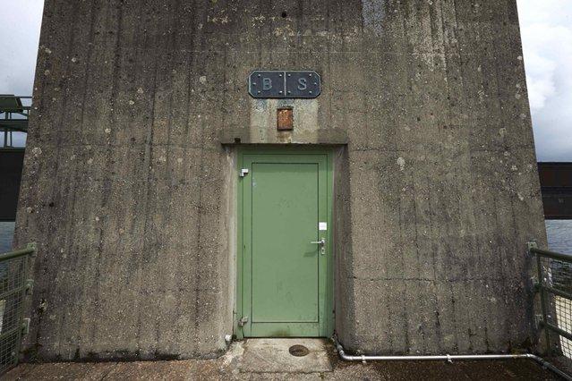A door is seen on the RADAG (Rheinkraftwerk Albbruck-Dogern AG) power dam on the Rhein river between Switzerland (R) and Germany in Leibstadt May 1, 2014. (Photo by Denis Balibouse/Reuters)
