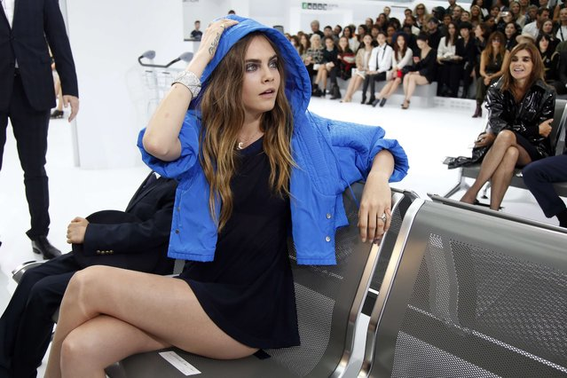 Model Cara Delevingne arrives to attend German designer Karl Lagerfeld's Spring/Summer 2016 women's ready-to-wear collection show for fashion house Chanel at the Grand Palais which is transformed into a Chanel airport during the Fashion Week in Paris, France, October 6, 2015. (Photo by Charles Platiau/Reuters)