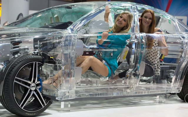 "Two models sit in an acrylic ""ZF-Car"" from the German manufacturer of the same name at the Automechanika automotive service industry trade fair in Frankfurt am Main, Germany, 12 September 2016. The Automechanika Fair runs from 13 to 17 September 2016. (Photo by Boris Rössler/EPA)"