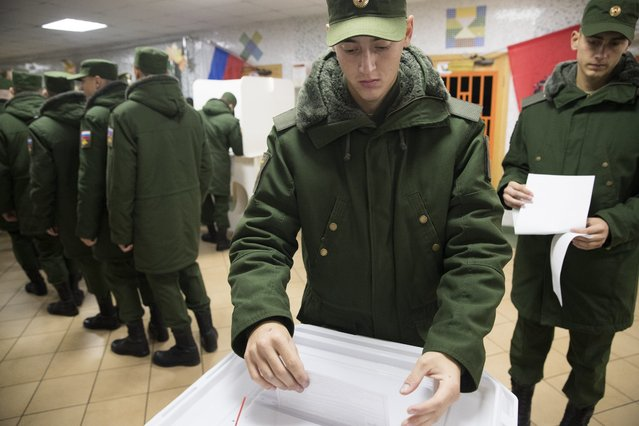 Russian military cadets cast their ballots at a polling station during a parliamentary elections in Moscow, Russia, Sunday, September 18, 2016. Russia's weekend parliament elections take place under new rules that in principle could bring genuine opposition into the national legislature. (Photo by Pavel Golovkin/AP Photo)