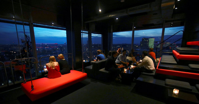 People sit at Solar bar in Berlin, Germany, September 2, 2016. Solar is one of many places to go out in Berlin with views over the city. The venue contains both a restaurant and a bar. (Photo by Hannibal Hanschke/Reuters)