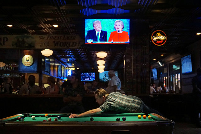 Patrons at McGregor's Bar and Grill watch the first televised debate between Democratic presidential candidate Hillary Clinton and Republican presidential candidate Donald Trump in San Diego, California, U.S. September 26, 2016. (Photo by Sandy Huffaker/Reuters)