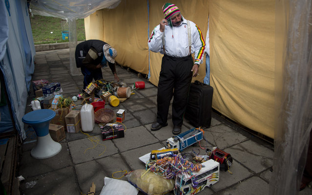 "In this February 6, 2018 photo, Juan Ricaldi starts assembling his costume to become the ""Ekeko"", the god of prosperity and the central figure of the Alasita Fair, in La Paz, Bolivia. ""I carry the soul of the Ekeko"", said the 59-year-old artisan who studies history at the local university. Ricaldi won this year's Ekeko competition. (Photo by Juan Karita/AP Photo)"