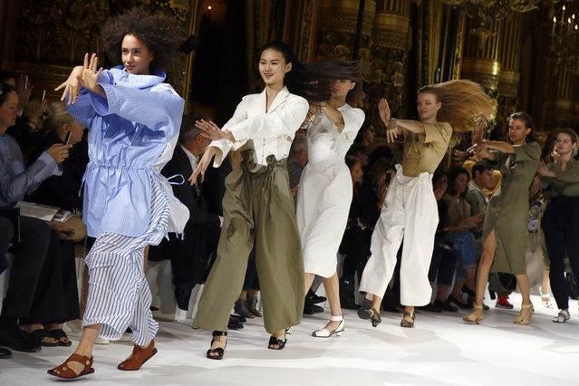 Models dance during the presentation of Stella McCartney's Spring-Summer 2017 ready-to-wear fashion collection presented Monday, October 3, 2016 in Paris. (Photo by Francois Mori/AP Photo)
