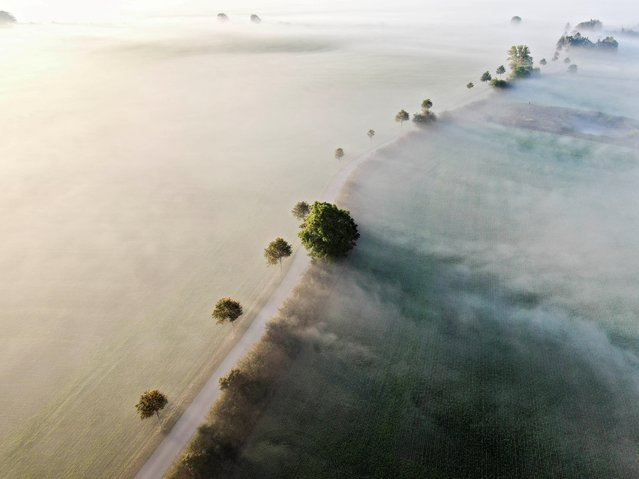 An areal view taken on September 22, 2020 shows a road in Kvaerndrup in the morning fog, on the island of Funen, Denmark. (Photo by Michael Bager/Ritzau Scanpix/AFP Photo)