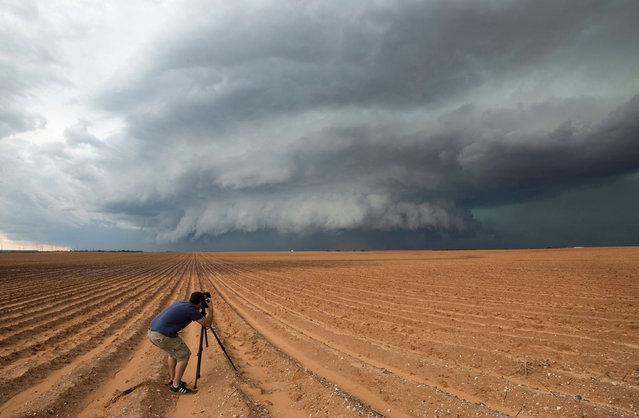 Mike capturing the storm in Big Spring, Texas on May 2014. (Photo by Mike Mezeul II/Caters News)