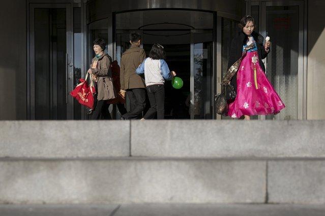 People visit the Pothonggang Department Store in central Pyongyang October 11, 2015. (Photo by Damir Sagolj/Reuters)