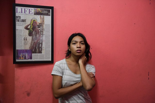 Transgender drag queen Aunchalee Pokinwuttipob, better known by the stage name, Angele Anang, 26, poses for a photograph in front of a newspaper depicting her when she won the Drag Race reality show, at her father's house in Ayutthaya, Thailand, September 15, 2020. (Photo by Chalinee Thirasupa/Reuters)