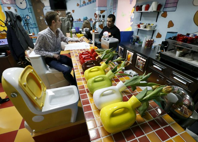 Flower vases designed in the likeness of urinals are seen on a counter at Crazy Toilet Cafe in central Moscow, Russia October 30, 2015. (Photo by Sergei Karpukhin/Reuters)