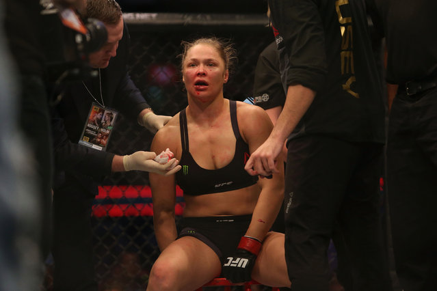 American professional wrestler Ronda Rousey of the United States receives medical treatment after being defeated by Holly Holm of the United States in their UFC women's bantamweight championship bout during the UFC 193 event at Etihad Stadium on November 15, 2015 in Melbourne, Australia. (Photo by Pat Scala/Zuffa LLC via Getty Images)