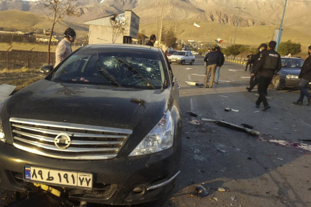 """This photo released by the semi-official Fars News Agency shows the scene where Mohsen Fakhrizadeh was killed in Absard, a small city just east of the capital, Tehran, Iran, Friday, November 27, 2020. Fakhrizadeh, an Iranian scientist that Israel alleged led the Islamic Republic's military nuclear program until its disbanding in the early 2000s was """"assassinated"""" Friday, state television said. (Photo by Fars News Agency via AP Photo)"""