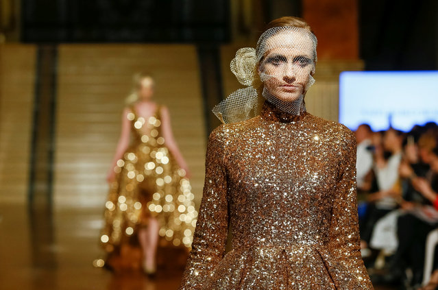 Models present creations by Kazakhstan's designer Naiyl Baikuchukov during Kazakhstan Fashion Week at National Academical Theater of Opera and Ballet in Almaty, Kazakhstan April 11, 2018. (Photo by Shamil Zhumatov/Reuters)