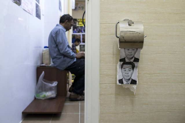Toilet paper printed with the face of embattled Hong Kong chief executive Leung Chun-ying is served inside the toilet of a themed guesthouse in Hong Kong December 30, 2014. (Photo by Tyrone Siu/Reuters)