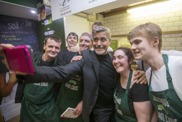 George Clooney taking a selfie with staff as he visits Social Bite, a cafe in Edinburgh which helps the homeless in Edinburgh, November 12, 2015. (Photo by Jeff Holmes/PA Wire via ZUMA Press)