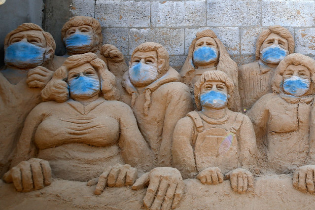 A sand sculpture by Palestinian artist Rana al-Ramlawi is pictured in her yard in Gaza City, during the novel coronavirus pandemic crisis, on April 3, 2020. (Photo by Mohammed Abed/AFP Photo)
