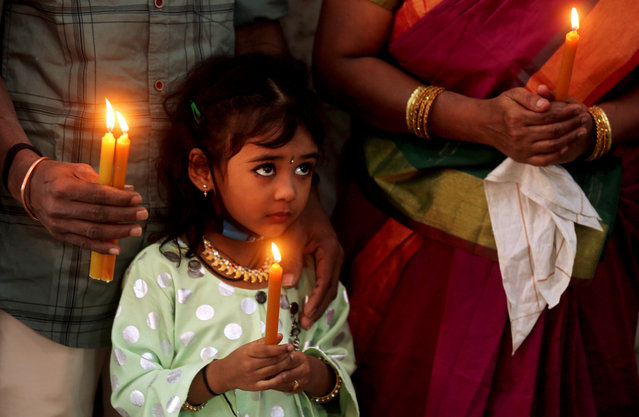 Indian Christians take part in Christmas prayers at the Infant Jesus church in Bangalore, India, 25 December 2020. Most Christians celebrate Christmas on 25 December to commemorate the birth of Jesus, the central figure of Christianity. (Photo by Jagadeesh N.V./EPA/EFE)
