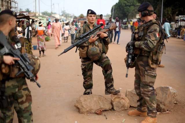 French peacekeeping soldiers patrol a street of the mostly muslim neighbourhood of PK 5 in Bangui, Central African Republic, November 25, 2015. (Photo by Siegfried Modola/Reuters)