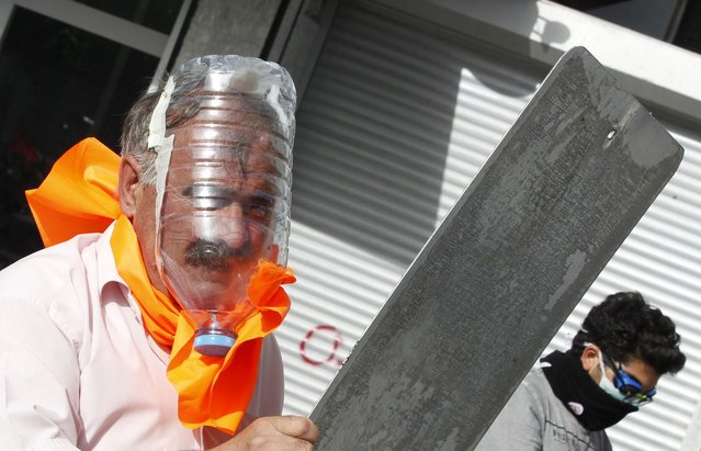 A demonstrator wears a gas mask made out of a plastic water bottle during a protest against Turkey's Prime Minister Tayyip Erdogan and his ruling AK Party in central Ankara June 2, 2013. (Photo by Umit Bektas/Reuters)