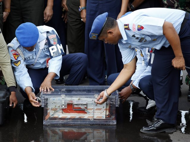 The flight data recorder of AirAsia QZ8501 is secured in a see-through case at the airbase in Pangkalan Bun, Central Kalimantan January 12, 2015. (Photo by Darren Whiteside/Reuters)