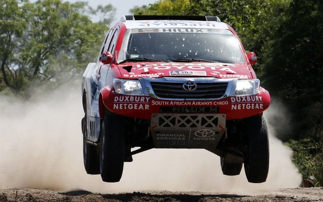 Toyota driver Giniel de Villiers of South Africa drives during the first stage of the Dakar Rally 2015 from Buenos Aires to Villa Carlos Paz January 4, 2015. (Photo by Jean-Paul Pelissier/Reuters)