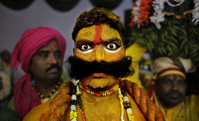 An artist from the state of Telangana reacts to the camera as they wait for their turn to perform during a media preview displaying a glimpse of culture of different parts of India, in New Delhi, India, Thursday, January 22, 2015. The tableaux will be part of the Indian Republic Day parade on Jan. 26. (Photo by Altaf Qadri/AP Photo)