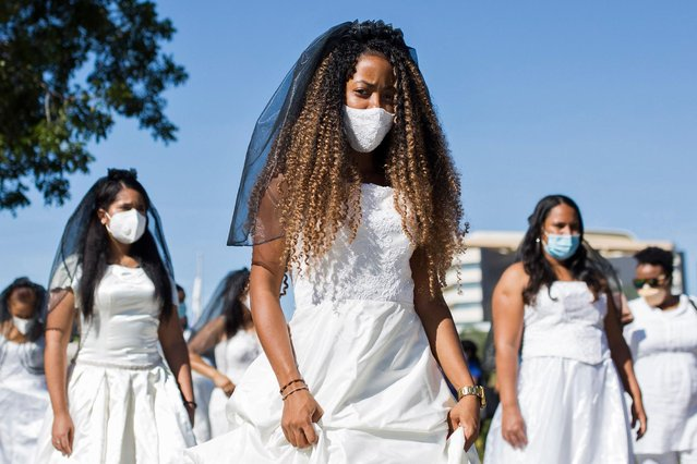 "Students from the Autonomous University participate in the tenth edition of the ""March of the Brides"" in Santo Domingo on October 20, 2020. The march aims to sensitize the public about the proliferation of domestic and gender violence in the Dominican Republic. (Photo by Erika Santelices/AFP Photo)"