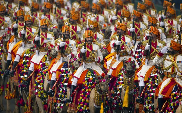 Camel mounted Indian soldiers march down Rajpath, a ceremonial boulevard, during full dress rehearsal ahead of the Republic Day parade in New Delhi, India, Friday, January 23, 2015. (Photo by Saurabh Das/AP Photo)
