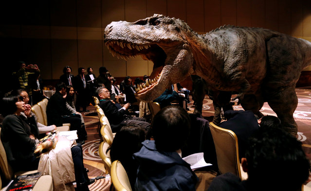 "Japan's On-Art Corp's eight metre tall dinosaur-shaped mechanical suit robot ""TRX03"" performs during its unveiling in Tokyo, Japan November 10, 2016. (Photo by Toru Hanai/Reuters)"