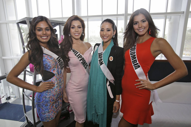 Miss Universe contestants Noyonita Lodh, left, of India, Mary Jean Lastimosa, second from left, of the Philippines, Keiko Tsuji, second from right, of Japan, and Paulina Vega of Colombia pose for photos during a break in rehearsals, Saturday, January 24, 2015, At Florida International University in Miami. (Photo by Wilfredo Lee/AP Photo)
