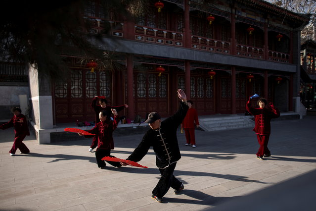 People perform a traditional dance in Daguanyuan Park as China celebrates Lunar New Year of the Ox following an outbreak of the coronavirus disease (COVID-19) in Beijing, China, February 15, 2021. (Photo by Thomas Peter/Reuters)