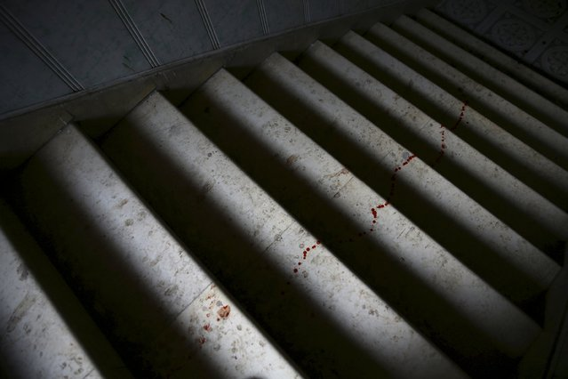 Blood drops are seen on the stairway of a field hospital, after what activists said was shelling by forces loyal to Syria's President Bashar al-Assad in the Douma neighborhood of Damascus, Syria December 2, 2015. (Photo by Bassam Khabieh/Reuters)