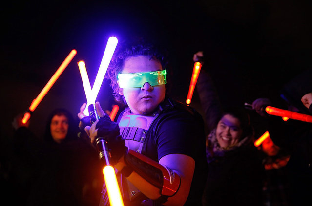 "Fans participate in the Star Wars Lightsaber Battle ""The Light Battle Tour"" at Washington Square Park on December 18, 2015 in New York City. (Photo by John Lamparski/Getty Images)"