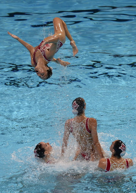 Spain's synchronised swimming team  compete in the team free preliminary round during the synchronised swimming competition in the FINA World Championships at the Palau Sant Jordi in Barcelona, on July 23, 2013. (Photo by Lluis Gene/AFP Photo)