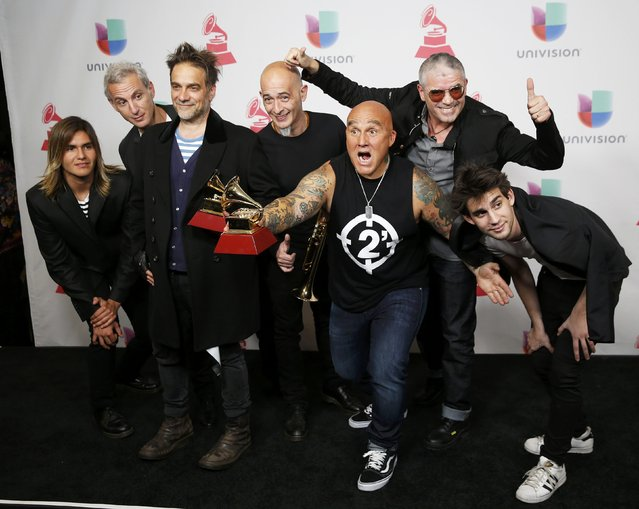 """Los Fabulosos Cadillacs pose with their award for Best Rock Album for """"La Salvacion De Solo y Juan"""" and Flavio Cianciarulo (3rd-R) holds his award for Best Rock Song for """"La Tormenta"""" during the 17th Annual Latin Grammy Awards in Las Vegas, Nevada, U.S., November 17, 2016. (Photo by Steve Marcus/Reuters)"""