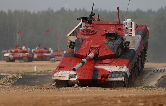 A tank operated by a crew from China drives during the Tank Biathlon competition at the International Army Games 2018, in Alabino outside Moscow, Russia on July 28, 2018. (Photo by Sergei Karpukhin/Reuters)