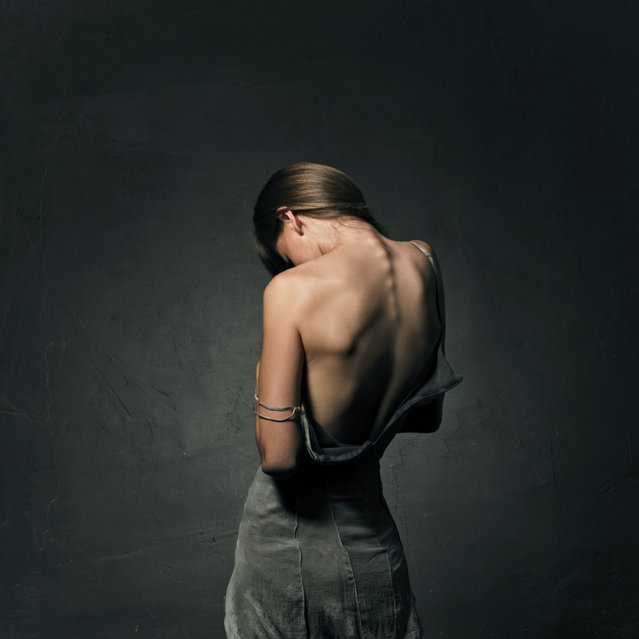 """""""Woman in dress with naked back"""". (Photo by Vladimir Serov)"""